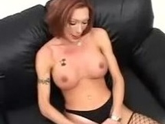 Redhead shemale whoops out a cock that's pretty burly