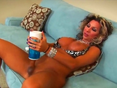 Sexy shemale with big boobs and a big stiff cock uses a pocket pussy to please her self