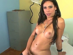 Bruna B is a gorgeous shemale model with long dark hair, round tits and hard dick. Mouth-watering transsexual goddess in black stockings jerks at the office int his scene.