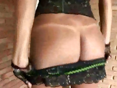 Sexy brunette shemale in lingerie jerking her cock